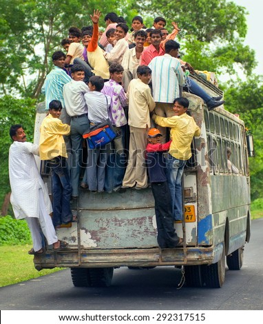 JHANSI, INDIA - AUGUST 19: Workers returning home at the evening in an overloaded bus in Jhansi province. Jhansi, India on August 19, 2013 - stock photo