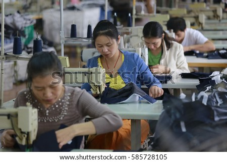 JIANGXI CHINA-SEP 26,2013:Female labors work in a cloth factory which export to European Union in Jiujiang, Jiangxi province, East China.