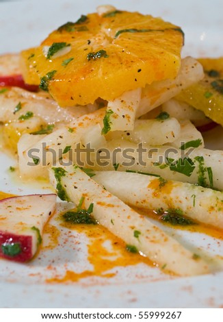 jicama salad with fresh oranges and radish - stock photo