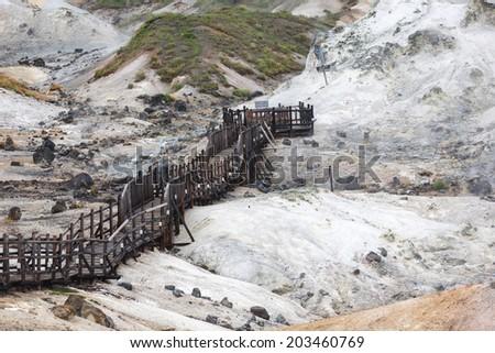 Jigokudani hell valley walking trail in Noboribetsu, Hokkaido, Japan - stock photo