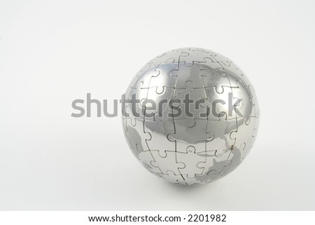 Jigsaw globe against a white background - stock photo