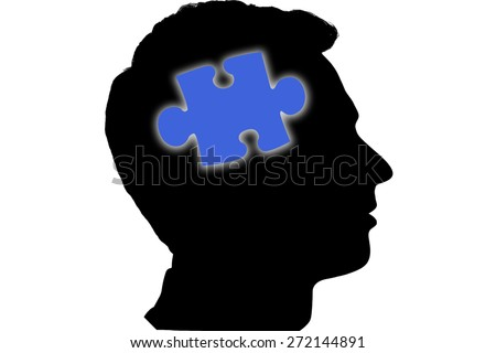 Jigsaw piece against silhouette of head - stock photo