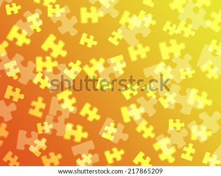 Jigsaw pieces placed on an orange gradient background - stock photo