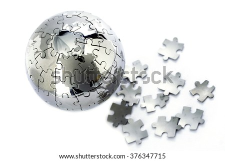 Jigsaw puzzle globe and pieces on white background