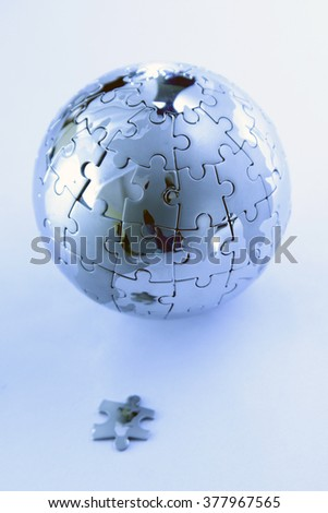 Jigsaw puzzle globe isolated on white