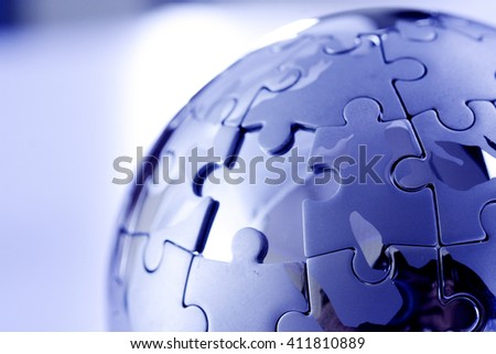 Jigsaw puzzle globe with a missing puzzle piece - stock photo