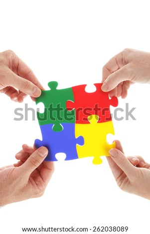 Jigsaw puzzle in hands - stock photo