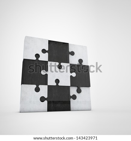 jigsaw puzzle made of bright and dark stone pieces - stock photo