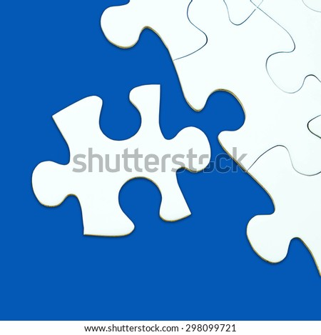 Jigsaw puzzle on blue background for business concepts template such as success, teamwork, E-commerce