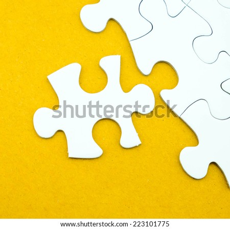 Jigsaw puzzle on recycle paper for business concepts such as success, problem solution, idea, teamwork etc.