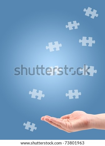 Jigsaw puzzle pieces isolated against a blue background - stock photo