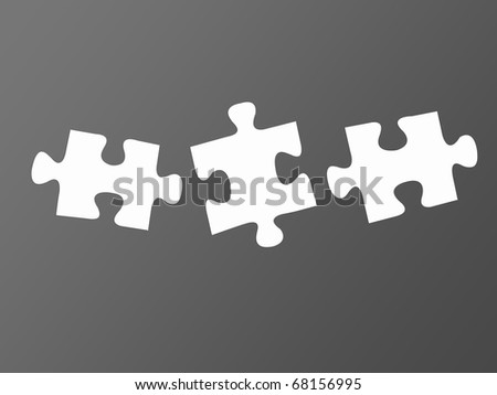 Jigsaw puzzle pieces isolated against a grey background - stock photo