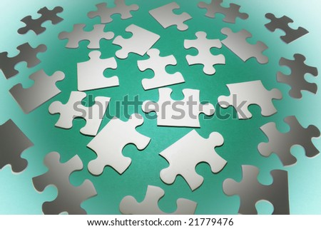 Jigsaw Puzzle Pieces on Green Background