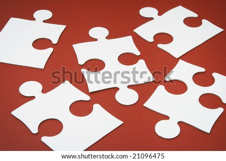 Jigsaw Puzzle Pieces on Red Background
