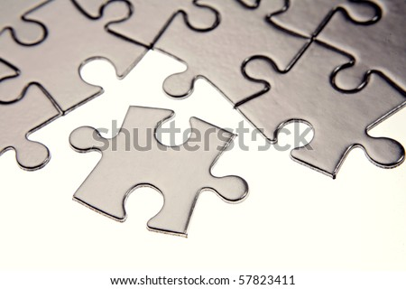 Jigsaw puzzle pieces on white - stock photo