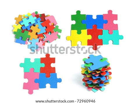 Jigsaw Puzzle Pieces on White Background - stock photo