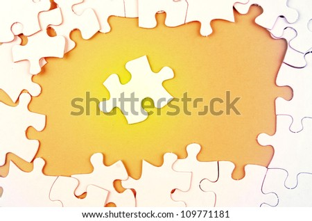 Jigsaw puzzle pieces, one apart - stock photo