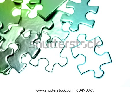 Jigsaw puzzle pieces scattered on color background - stock photo