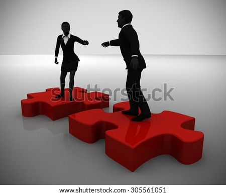 Jigsaw Puzzle recruiting a candidate. One executive recruiting another while on top of pieces of a jigsaw puzzle. - stock photo