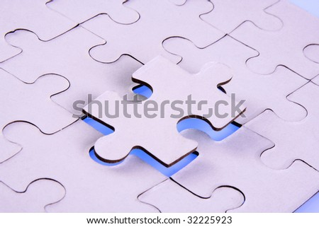 Jigsaw puzzle-Replacing the jigsaw piece - stock photo