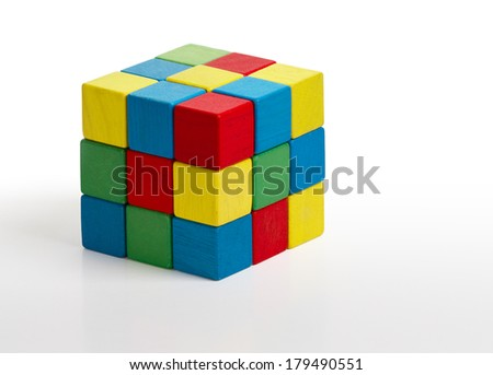 jigsaw puzzle rubik cube toy, multicolor wooden colorful game pieces over white background  - stock photo