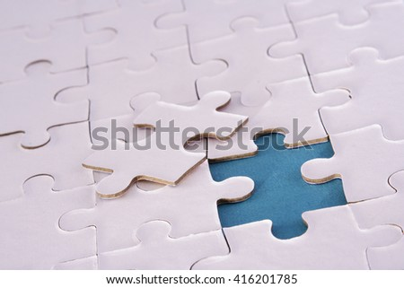 Jigsaw puzzle with a missing piece