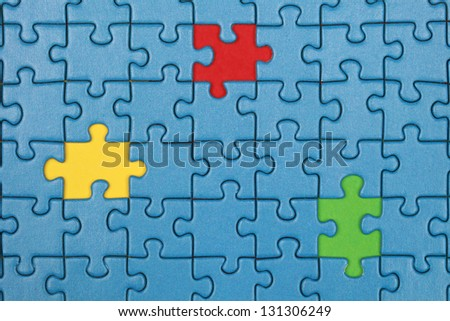 Jigsaw Puzzle with missing pieces in three different colors - stock photo