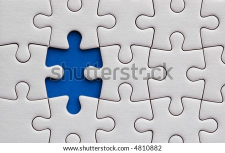 Jigsaw puzzle with one piece missing - stock photo