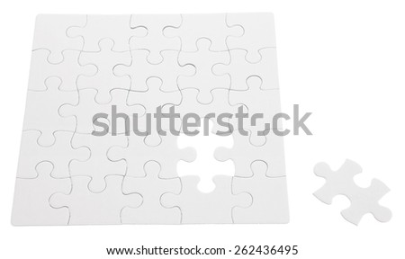 Jigsaw puzzle with piece out - stock photo