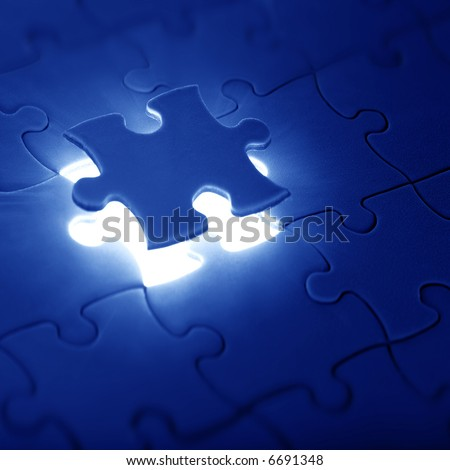 jigsaw puzzle with the missing piece - stock photo