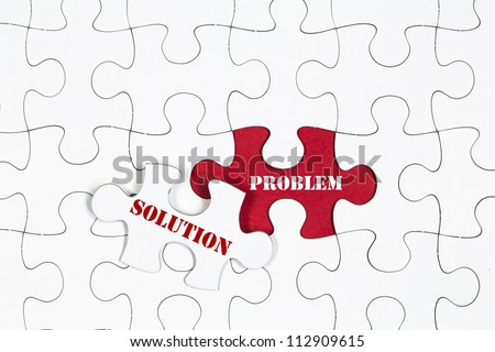 jigsaw puzzle with the missing piece, solution concept - stock photo