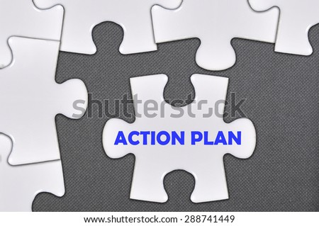 jigsaw puzzle written word action plan . - stock photo