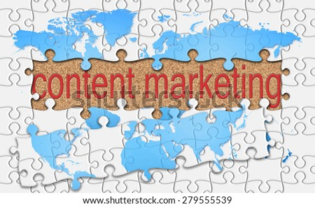 jigsaw reveal content marketing word on cork background. - stock photo