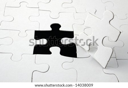 jigsaw with man shaped piece out of place - stock photo