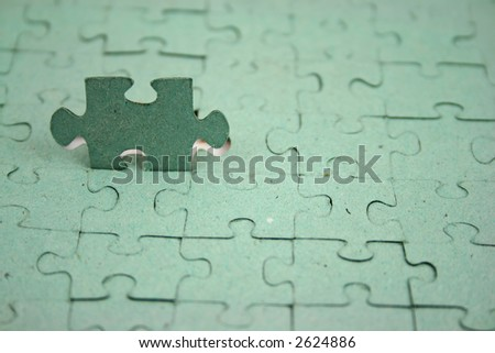 Jigsaw with one pice upright shallow DOF