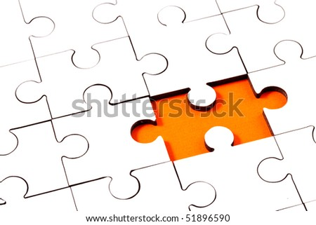 Jigsaw with one piece missing revealing orange background - stock photo