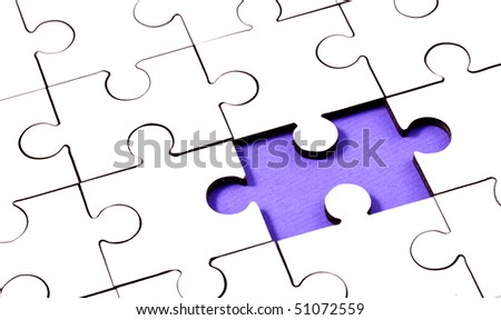 Jigsaw With Piece Missing Showing Purple Underlay - stock photo