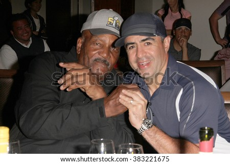 Jim Brown and Jose Alvarado at dinner during the Inaugural Stephen Bishop celebrity golf invitational benefiting R.A.K.E. on Feb. 15, 2016 at Calabasas Country Club in Calabasas, CA. - stock photo