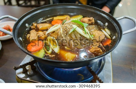 Jim dak or Jjim Dak- local Korean food made with chicken, various vegetables marinated in a ganjang (Korean soy sauce) on top of stove - stock photo