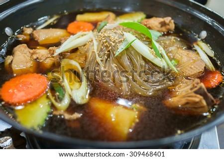 Jim dak or Jjim Dak- local Korean food made with chicken, various vegetables marinated in a ganjang (Korean soy sauce) on top of stove - stock photo
