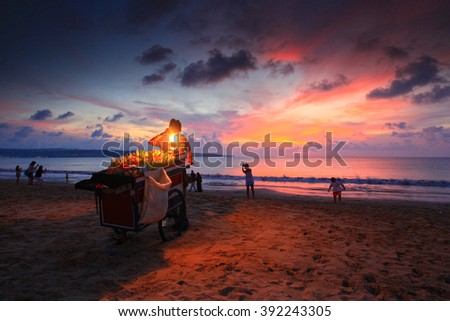 Jimbaran, Bali Indonesia most famous roasted corn with colorful sunset in background - stock photo