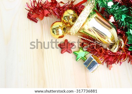 Jingle bell ,Christmas star on wooden background with copy space.
