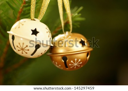 Jingle bells on Christmas tree with copy space. Selective focus, shallow DOF. - stock photo