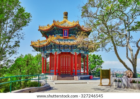 "Jingshan Park, Beijing, Pavilion or the Coal Mountain, near the Forbidden City,Guanmiao Pavilion.Inscription translate- ""Guanmiao Pavilion."" China - stock photo"