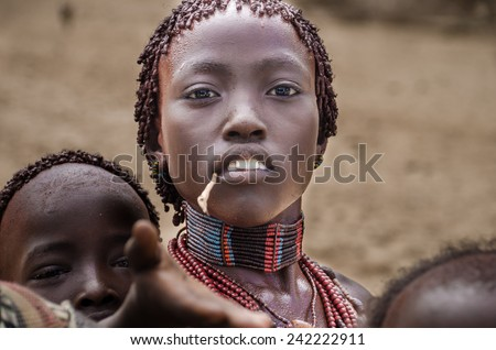 JINKA, ETHIOPIA, - 12 AUGUST: unidentified woman from Hamer tribe in  Jinka Ethiopia, on 12 August 2014. Woman from Hamer tribe weave their hairs with soil - stock photo