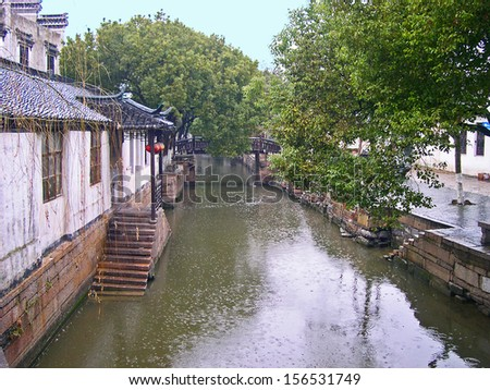 JINXI, SHANGHAI, CHINA  FEBRUARY 6: raining on a typical village water way. The ancient village is a Shanghai tourist attraction with 100000 visitors per year. February 6, 2005, Jinxi, China