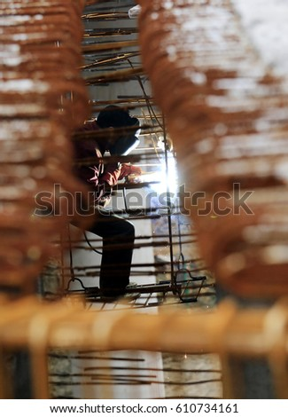 JIUJIANG CHINA-February 26, 2014: in the highway engineering across the road bridge, the workers are tense welding construction.