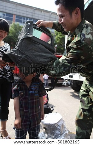 JIUJIANG CHINA-MAY 8, 2011:mother's Day parent-child activities, the children in the mother's lead down to the armed police fire brigade, use of fire equipment, common learning fire safety knowledge.
