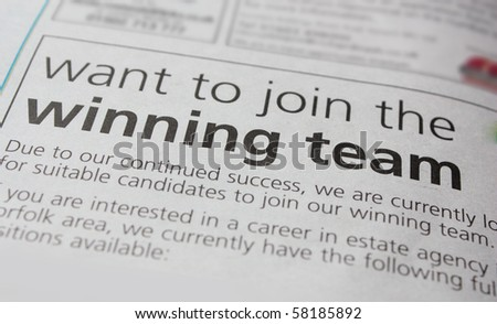 Job advert in a newspaper, inviting applicants to join the winning team.