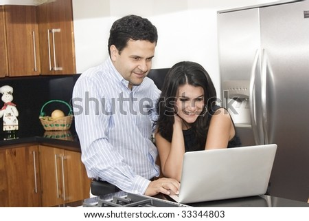 Job at home, lovely couple working in kitchen